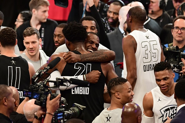 LOS ANGELES, CA - FEBRUARY 18: Joel Embiid #21 of Team Stephen and LeBron James #23 of Team LeBron hug after the NBA All-Star Game as a part of 2018 NBA All-Star Weekend at STAPLES Center on February 18, 2018 in Los Angeles, California. NOTE TO USER: User expressly acknowledges and agrees that, by downloading and/or using this photograph, user is consenting to the terms and conditions of the Getty Images License Agreement. Mandatory Copyright Notice: Copyright 2018 NBAE (Photo by Garrett Ellwood/NBAE via Getty Images)